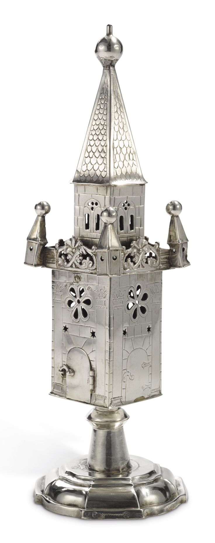 German silver large spice tower, Martin Carl Hanias, gen. Dublon, Nuremberg, circa 1730-40 -  each side of the central section engraved with brickwork and pillars enclosing a door or simulated door, pierced with stars and a rosette,  surmounted by a gallery with four turrets at the corners and a hexagonal pierced and engraved spire, set on stepped base, marked on base, body and spine, each with maker's mark and town mark. height 11 1/2 in . 29.2 cm.