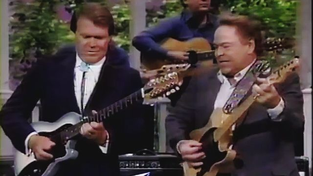 "Glen Campbell Tears It Up with Roy Clark on ""Ghost Riders"" 