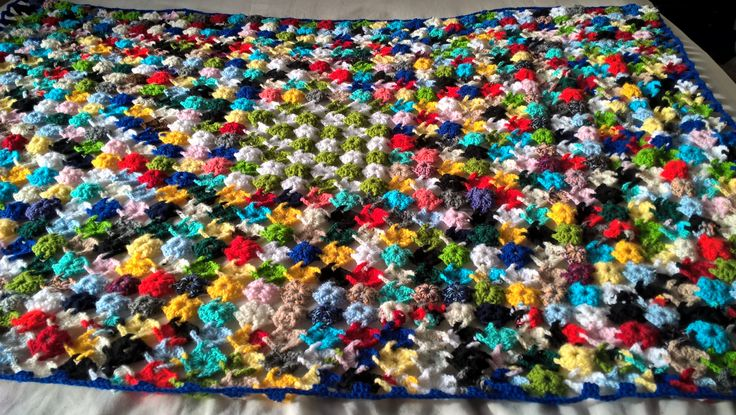 Multicoloured throw made up of tiny interlocking granny squares. Bright and cheerful  OOAK crochet cover. Measures 52inch x 36inch. by Nobodyknitsitbetter on Etsy
