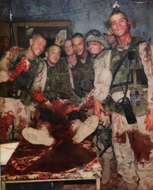 """Ok so this is kind of awful but it's also kind of hilarious...the black hawk down boys on set, presumably filming the """"spurting artery"""" scene."""