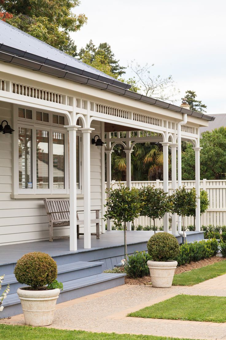 The back of the house has an elegant full-length veranda, finished in Resene Non-Skid Deck & Path tinted to Resene Shuttle Grey. The weatherboards are Resene Thorndon Cream with trims in Resene Eighth Thorndon Cream, window frames in Resene Half Thorndon Cream and sills in Resene Triple Thorndon Cream.  Photo by The Official Photographers, produced by Jessica Judge.
