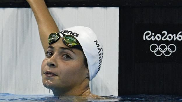 Yusra Mardini becomes the first athlete to represent the refugee team at Rio 2016, 12 months after fleeing Syria.