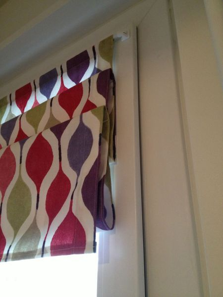 Roman shade but using magnets and can be let down. Perfect for kitchen door window.