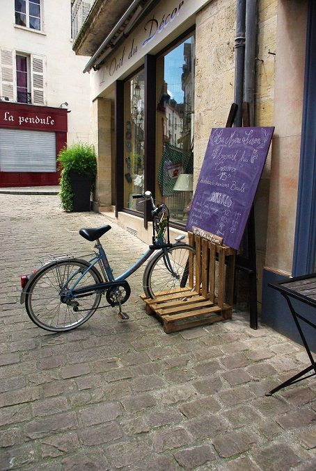 Pallet bicycle stand- Great Idea for kids to get their bikes out easier!
