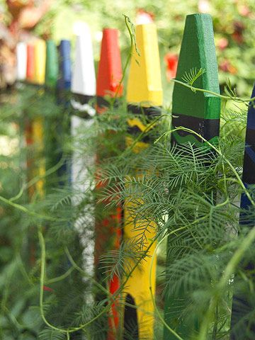 Picket fence painted like crayons.  Cute idea for a childrens' garden.