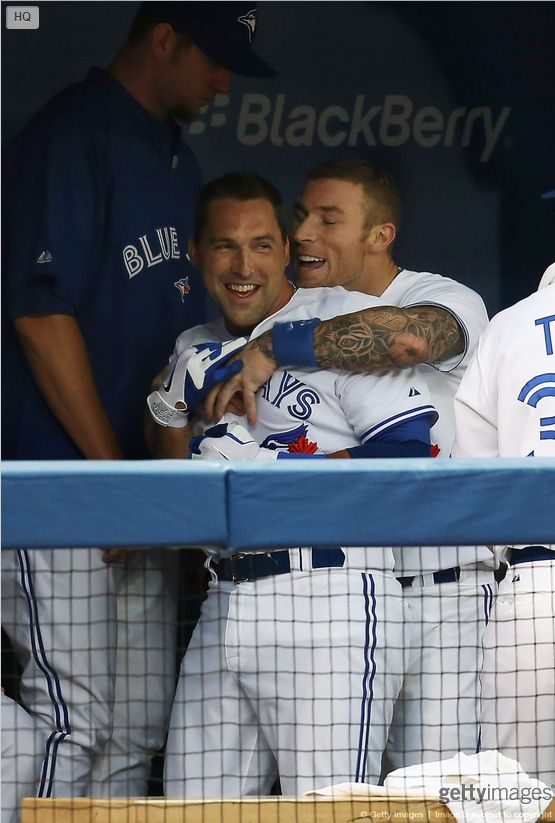 Mark DeRosa of the Toronto Blue Jays is congratulated byBrett Lawrieafter hitting a solo home run on July 23, 2013.