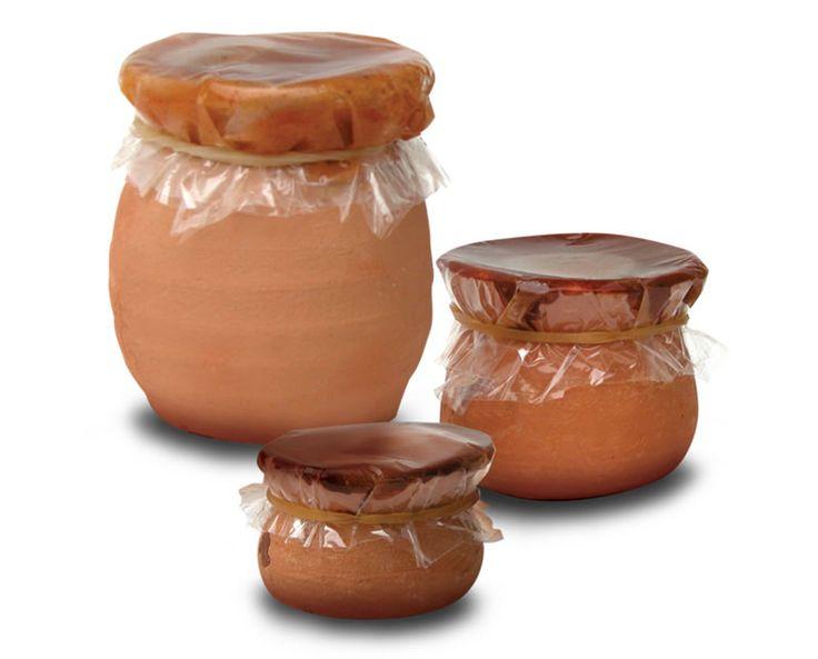 ollita de barro con pulpa de tamarindo
