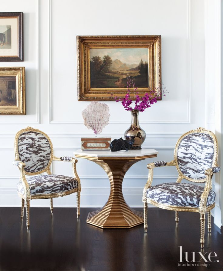 In a corner of the living room, a playful zebra pattern—Schumacher's Serengeti Silk—on the owners' gilt fauteuils dials down the formality. The sculptural silhouette of a Bunny Williams Hourglass table stands out against white walls. Summer Thornton Design