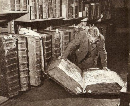c. 1940s: Woman with books