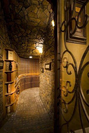 Mediterranean Wine Cellar with Designer series 95-bottle 5-column wine rack with display row, Built-in bookshelf, Wall sconce
