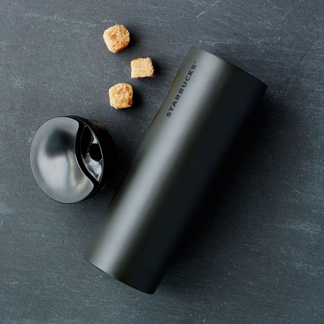 A+slender+stainless+steel+tumbler+with+a+cool+grip+feature+and+swivel+lid.