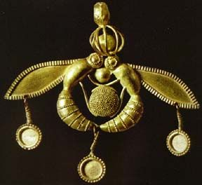 Bee Pendant, Minoan, Mallia, Crete, 1700-1500 BC  Gold Bee Pendant  Cast gold found at Chrysolakos at Malia. The two bees are taking a drop of honey to the hive. metalworking  1800-1700 BC