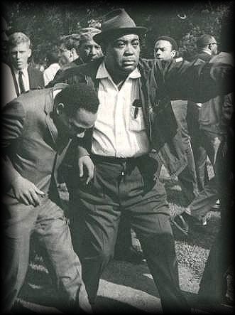 Martin Luther King meets racism in Chicago. | Dr. Martin Luther King Jr. holds his head after being struck by a rock as he led 600 demonstrators on a civil-rights march through crowds of angry whites in the Gage Park section of Chicago's southwest side. Aug. 6, 1966.