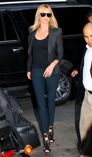 Charlize Theron flawlessly executes Stella McCartney's 'Velez' dark petrol blue skinny pant look.