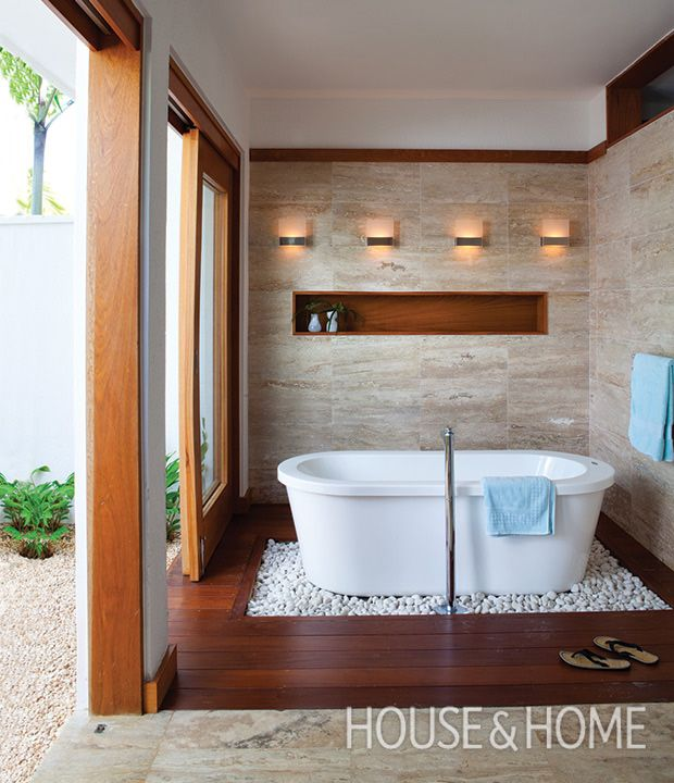 spa like bathroom blurs the lines between indoor and outdoor spaces