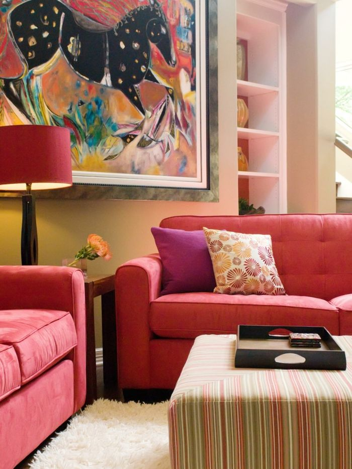 A pair of red sofas center around a striped ottoman  which can double as  extra seating when entertaining  A large abstract painting is the wow  factor in  40 best Red Curtains images on Pinterest   Living room ideas  . Red Room Decor. Home Design Ideas