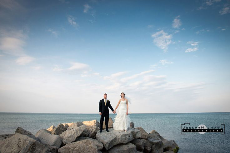 Lakeview Hamilton Wedding Photography, Bride and Groom on Rocks on Lake Ontario, Bride and Groom with Beautiful Blue Skies on Water