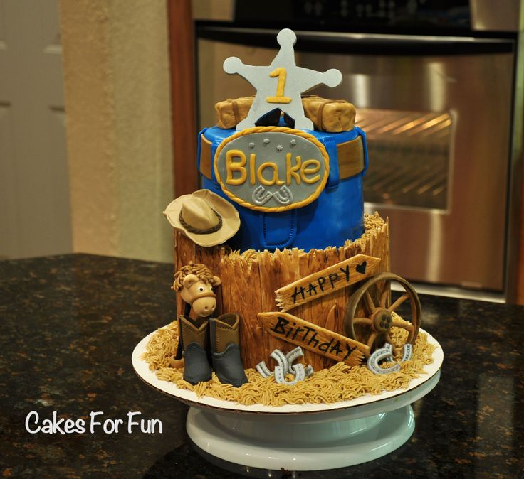 Western birthday cake for babies first birthday.  All decorations are edible (made with fondant)