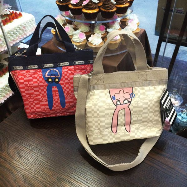 Lesportsac Handbag up:24.5CM,down:18CM  down width:7.5CM   height:19CM 7501 24USD