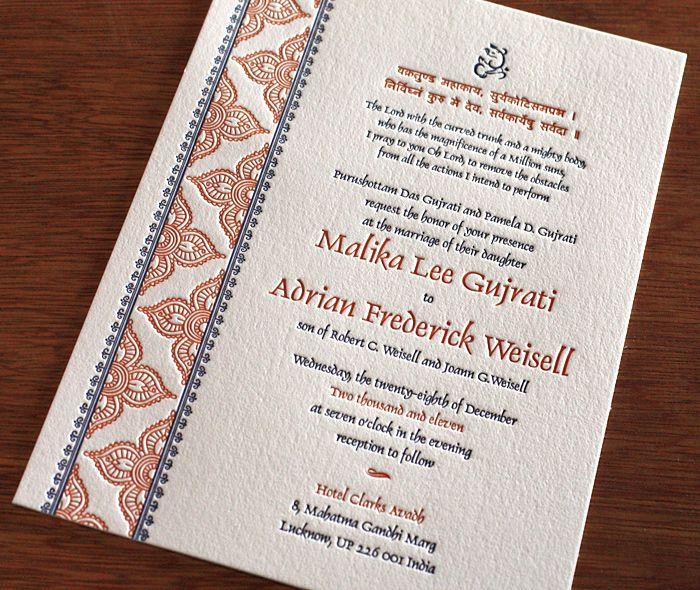 formal indian anglo wedding invitation with ganesh & traditional red blue pattern