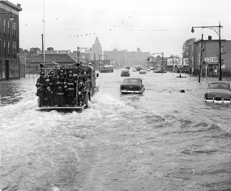 A fire tender being driven through a flooded street in New York street in the wake of Hurricane Donna in which 135 people lost their lives, 16th September 1960