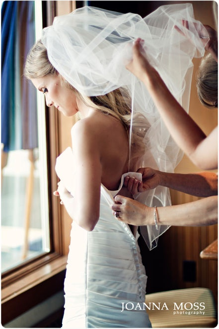 A stunning shot of a bride getting dressed | Joanna Moss Photography @Joanna Moss