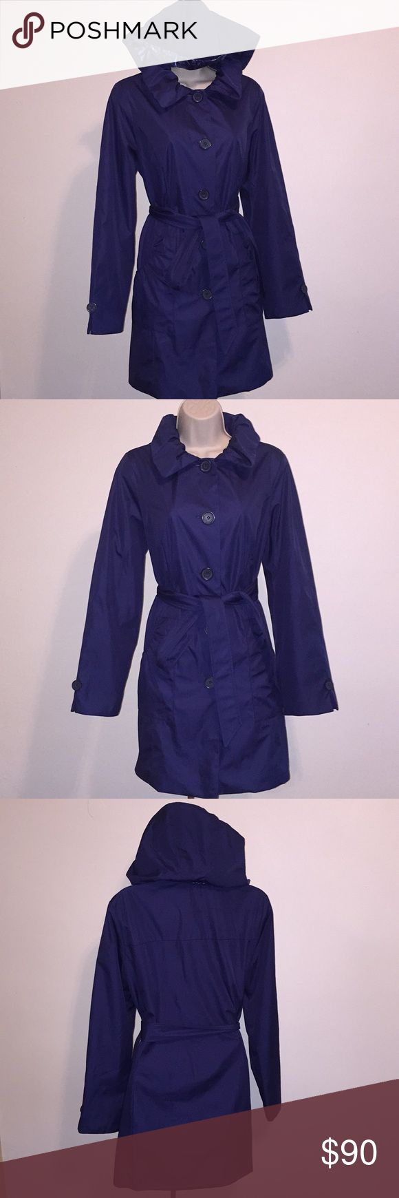 Dennis basso rain coat bleu small NWOT Dennis by Dennis basso raincoat small size blue color this is a hooded raincoat has a zipper around the neck water resistant button down on front two pockets and a belt fabric content SHELL & LINING 100% Polyester. Very warm comfortable and cute coat by Dennis Dennis Basso Jackets & Coats