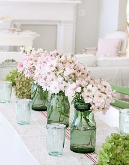 Centerpiece idea: mixed green glass with light purple flowers (this picture kinds of gets at it)