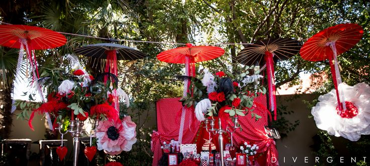 Red, Black and White themed garden birthday party hanging umbrellas