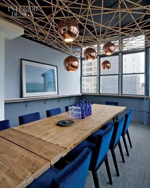 Made for TV. Roberto Menghi designed the pendant fixtures in a meeting room with a ceiling installation by mixed-media artist Jason Singleton.