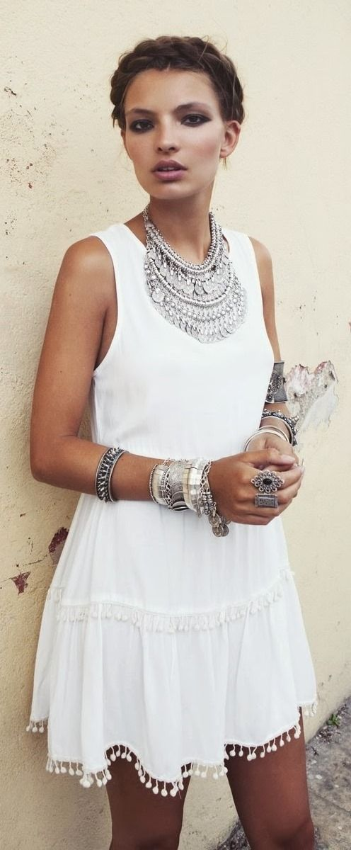 Fashion trends   White boho dress with braid crown and oversized silver accessories