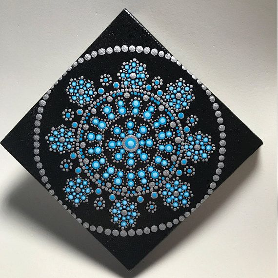 Hand painted with acrylic in Silver and Turquoise, sprayed with an acrylic sealer to protect the colors. Canvas size is 4 X 4.