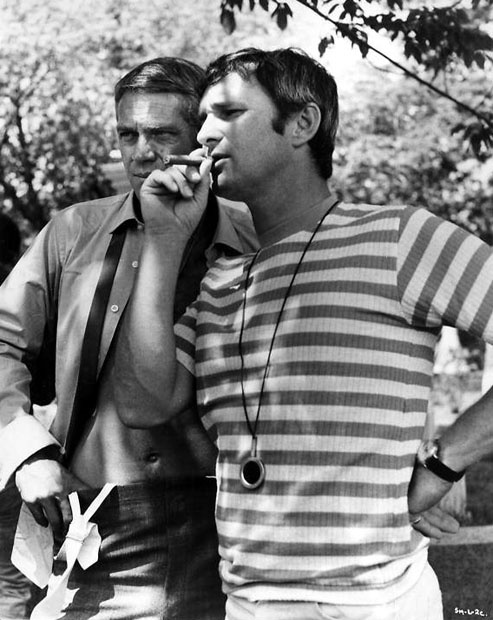 Steve McQueen and director Norman Jewison between scenes of The Thomas Crown Affair. 1968