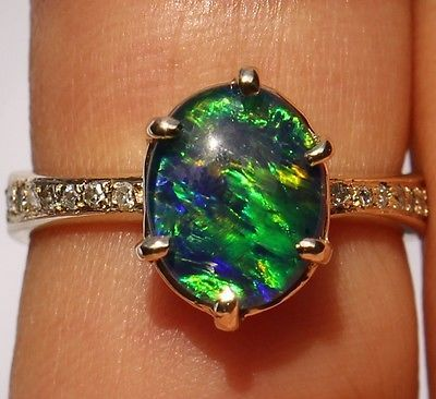 I love black opals!  Gorgeous 14k Australian Black Opal Diamond Ring Blue Green Ocean Colors | eBay