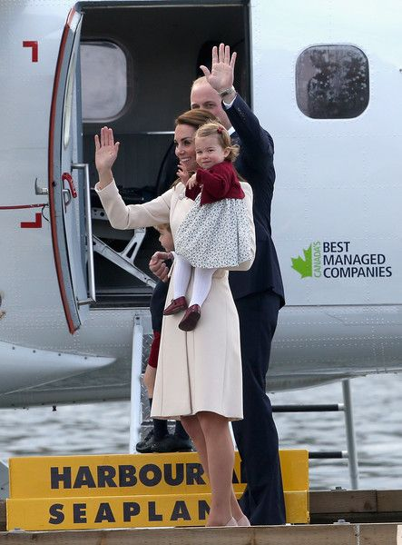 \Prince William, Duke of Cambridge, Prince George of Cambridge, Catherine, Duchess of Cambridge and Princess Charlotte wave as they leave from Victoria Harbour to board a sea-plane on the final day of their Royal Tour of Canada on October 1, 2016 in Victoria, Canada.