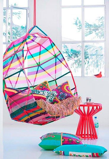 So much color in this picture, it's almost to much!! But that chair I need in my life!! :-)