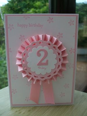 Great age card idea...this would be really cool if  you can put a pin on the back of the ribbon so the birthday girl can wear it.