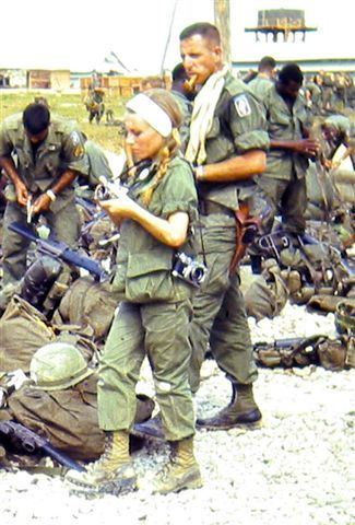 Photographer CATHERINE LEROY (1944 - 2006). During Vietnam War, shot some of most brutal photographs to come out of the country. (Captured by NVA during Tet Offensive.) Catherine Leroy was a French-born photojournalist and war photographer, whose stark images of battle illustrated the story of the Vietnam War in the pages of Life magazine and other publications.                http://noticeverything.files.wordpress.com/2012/03/rvn-1-img_0496a3.jpg