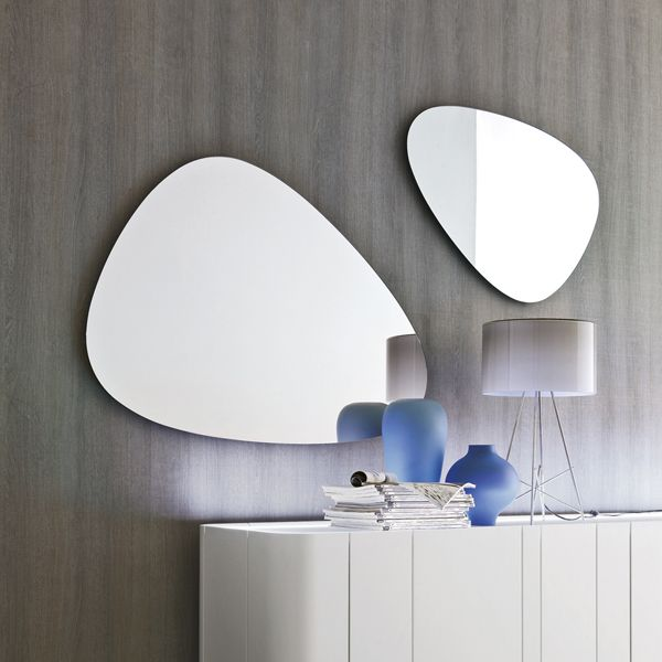 Silver, stone-shaped mirror.       (-T7529)