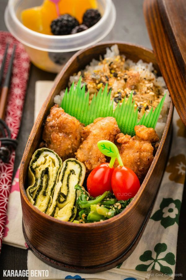 Karaage Bento | Easy Japanese Recipes at JustOneCookbook.com. Flavor shio koji karaage bento with tamagoyaki and spinach gomaae. Serve with fruits and grape tomatoes.