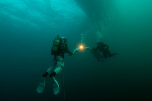 Olympic flame carried underwater in world's deepest lake (Lake Baikal)
