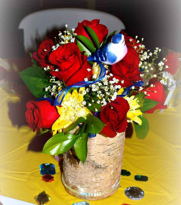 Snow white themed bridal shower centerpiece. Custom Design with red roses, yellow mum, and baby's breath. Check out other custom designs at ashleysfloral.net