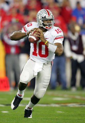 "Heisman Trophy winner Troy Smith.  Redshirted in 2002 and a kick return ""specialist"" in 2003, Smith was never a factor until halfway through 2004. He led Ohio State to a 4-1 record including a 37-21 upset win against No. 7 Michigan. 2006 regular season 12-0 and the ""Game of the Century"" beating Michigan 42-35 making Smith the 1st OSU QB to beat UM 3 times. Smith went 25-3 with OSU, two Big Ten titles, 65.3 completion % (school record), 6,888 total yds, 68 TDs, a 157.1 passer rating."