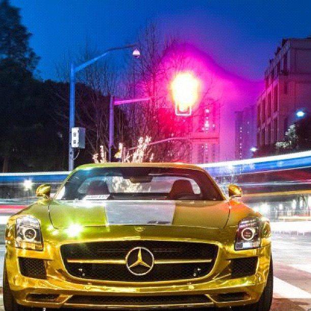 Gold Mercedes Benz SLS AMG