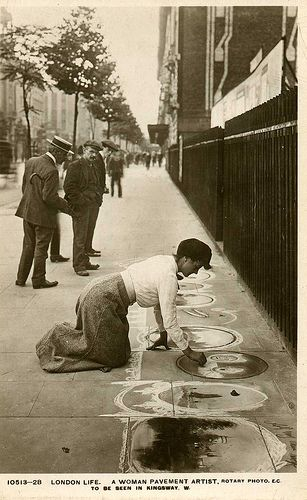 Postcard view of woman pavement artist, Kingsway, London, WC2, UK, circa 1910. Its almost like she is doing 'posh' street art, the fact the art is done directly onto the pavement and is done by a lady draws me towards the photograph.