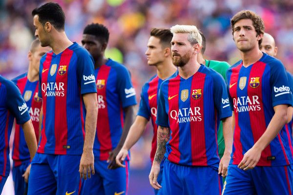 Lionel Messi (2nd R) of FC Barcelona looks on during the team official presentation ahead of the Joan Gamper trophy match between FC Barcelona and UC Sampdoria at Camp Nou on August 10, 2016 in Barcelona, Catalonia.