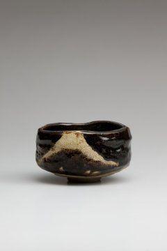 Black Raku tea bowl with a design of Mt. Fuji,  Tannyu X 19th century