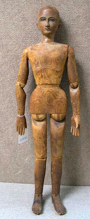 Folk Art Wood Jointed Doll.