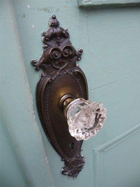 Oil rubbed bronze crystal door knob on Aqua door