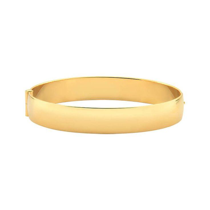 Pulseira algema lisa larga folheada a ouro 18k Dimensões aproximadas:Diâmetro interno: 5,8 cmLargura: 1 cmA New Bijoux oferece a garantia de 1 ano no banho desta peça.